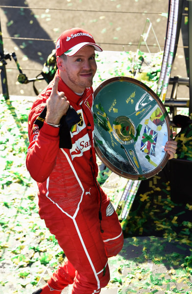Race winner Sebastian Vettel (GER) Ferrari celebrates with the trophy on the podium at Formula One World Championship, Rd1, Australian Grand Prix, Race, Albert Park, Melbourne, Australia, Sunday 26 March 2017.