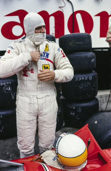 Jody Scheckter gets suited up to get into his Ferrari.