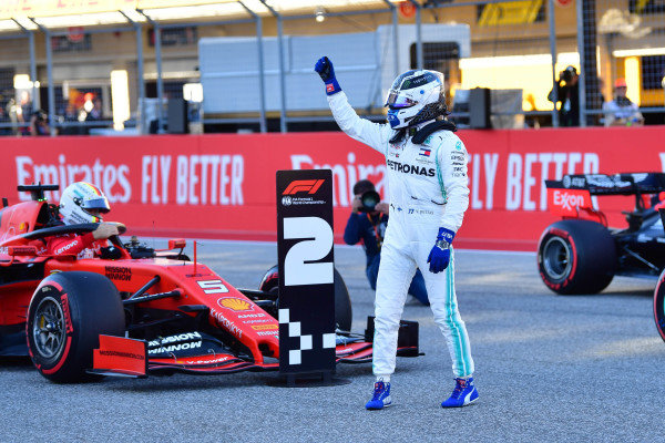 Valtteri Bottas, Mercedes AMG F1, waves to fans from the grid after securing pole