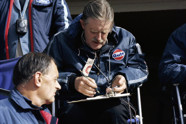 John Wyer looks at his timekeeper's chart.