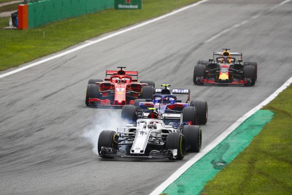 Charles Leclerc, Sauber C37 Ferrari, locks up leading Pierre Gasly, Toro Rosso STR13 Honda, Sebastian Vettel, Ferrari SF71H, and Daniel Ricciardo, Red Bull Racing RB14 Tag Heuer.