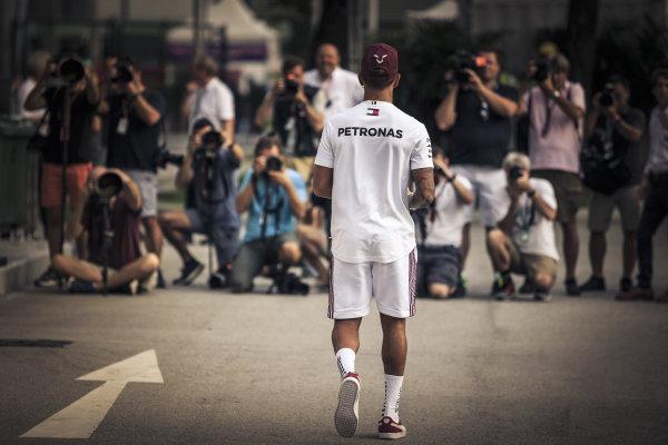 Lewis Hamilton, Mercedes AMG F1 walks towards photographers