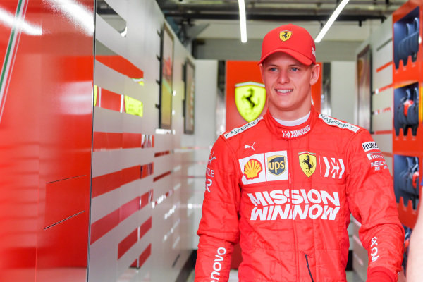 Mick Schumacher, Ferrari, emerges from the Ferrari garage in his overalls for the first time