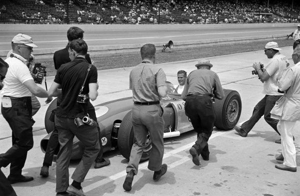 Bobby Unser, Andy Granatelli, Ferguson Novi, surrounded by photographers in the pit lane.