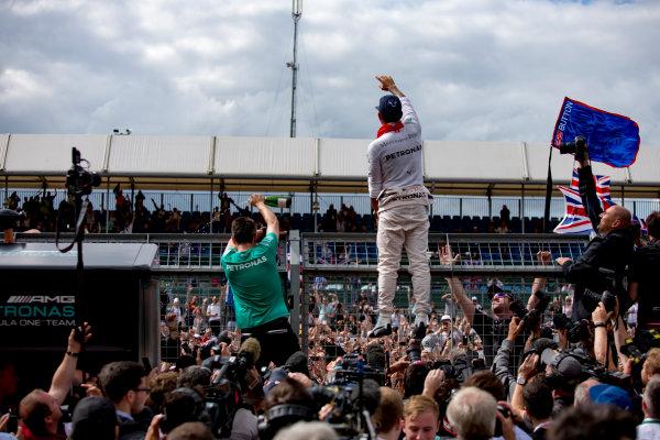 Silverstone, Northamptonshire, UK. Sunday 10 July 2016. Lewis Hamilton, Mercedes AMG, celebrates his win with the team. World Copyright: Zak Mauger/LAT Photographic ref: Digital Image _79P8770