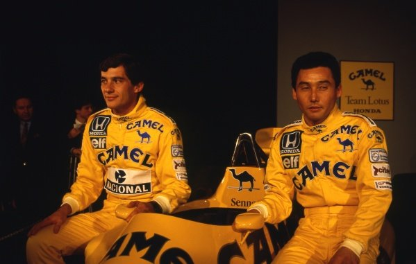 (L to R): Ayrton Senna (BRA) Lotus, with team mate Satoru Nakajima (JPN) at the unveiling of the Lotus 99T with Honda engines and Camel branding.