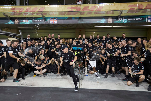 Yas Marina Circuit, Abu Dhabi, United Arab Emirates. Sunday 26 November 2017. Toto Wolff, Executive Director (Business), Mercedes AMG, Valtteri Bottas, Mercedes AMG, 1st Position, his wife Emelia, Lewis Hamilton, Mercedes AMG, 2nd Position, and the Mercedes team celebrate a great race result and another highly successful season. World Copyright: Steve Etherington/LAT Images  ref: Digital Image SNE13493