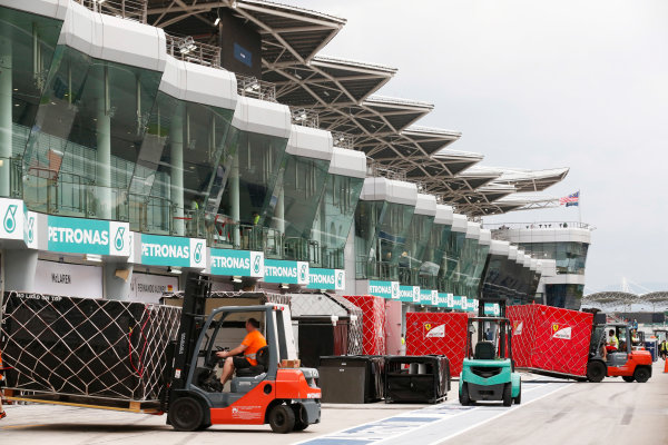 Sepang International Circuit, Sepang, Kuala Lumpur, Malaysia. Sunday 29 March 2015. The Ferrari team pack their equipment after a successful race weekend. World Copyright: Alastair Staley/LAT Photographic. ref: Digital Image _R6T6501