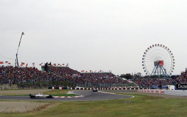 Suzuka, Japan.6-8 October 2000.Ralf Schumacher followed by team mate Jenson Button (both Williams FW22 BMW's).World Copyright Etherington/LAT Photographicref: 18 mb digital image