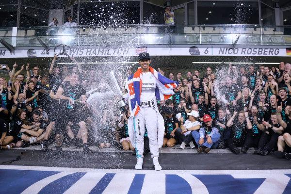 Yas Marina Circuit, Abu Dhabi, United Arab Emirates. Sunday 23 November 2014.  Lewis Hamilton and the Mercedes team celebrate championship victory.  World Copyright: Steve Etherington/LAT Photographic. ref: Digital Image SNE22520
