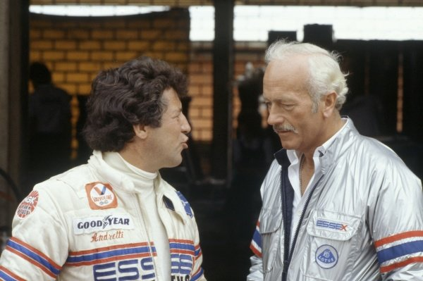 1980 South African Grand Prix.Kyalami, South Africa. 28 February-1 March 1980.Mario Andretti (Lotus 81-Ford Cosworth) with Essex Team Lotus owner Colin Chapman. Portrait.World Copyright: LAT PhotographicRef: 35mm transparency 80SA14