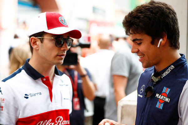 Charles Leclerc, Sauber, with Lance Stroll, Williams Racing.