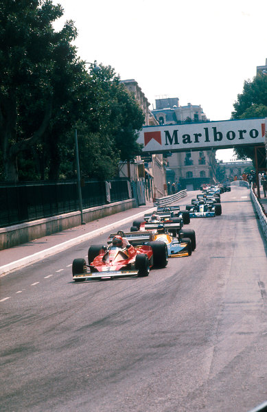 1976 Monaco Grand Prix. Monte Carlo, Monaco. 28-30 May 1976. Niki Lauda (Ferrari 312T2) 1st position leads Ronnie Peterson (March 761 Ford) and the rest into Mirabeau. Ref-76MON16. World Copyright - LAT Photographic