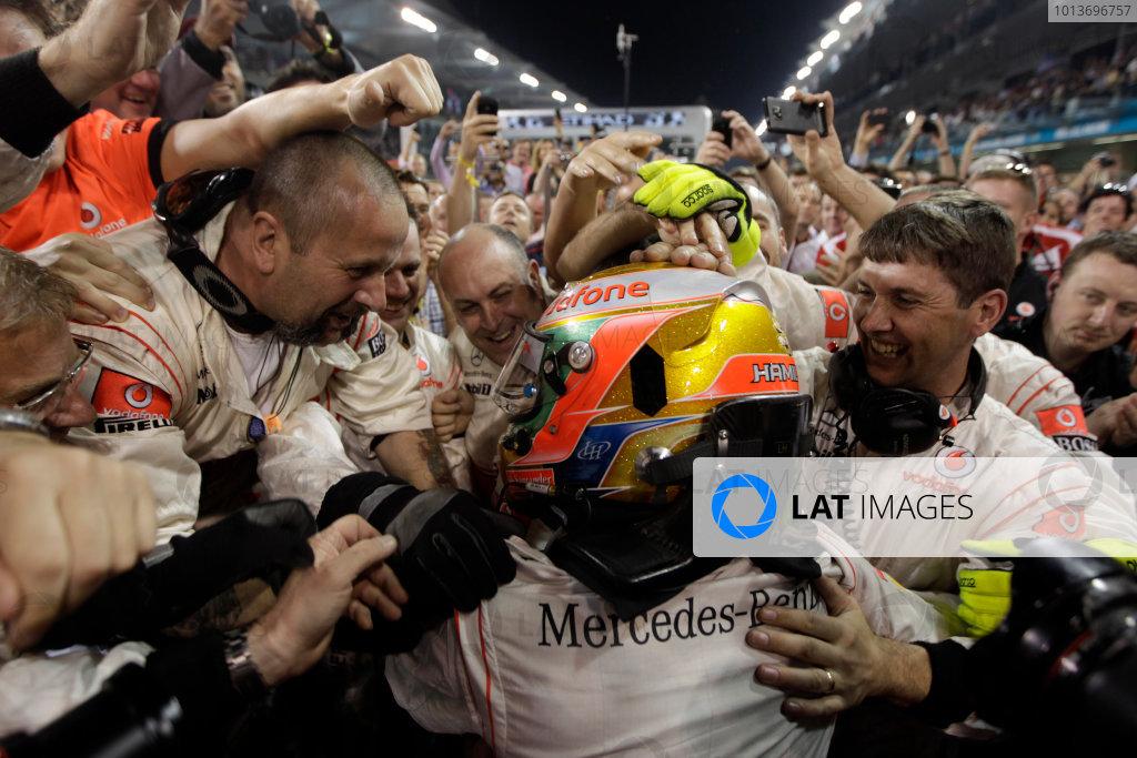 Yas Marina Circuit, Abu Dhabi, United Arab Emirates13th November 2011.Lewis Hamilton, McLaren MP4-26 Mercedes, 1st position, celebrates with his team in Parc Ferme. Portrait. Helmets. Finish. World Copyright:Glenn Dunbar/LAT Photographic ref: Digital Image _G7C5740