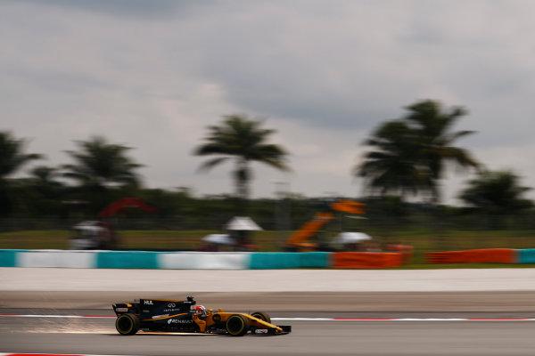 Sepang International Circuit, Sepang, Malaysia. Friday 29 September 2017. Nico Hulkenberg, Renault R.S.17., strikes up sparks. World Copyright: Glenn Dunbar/LAT Images  ref: Digital Image _31I0316