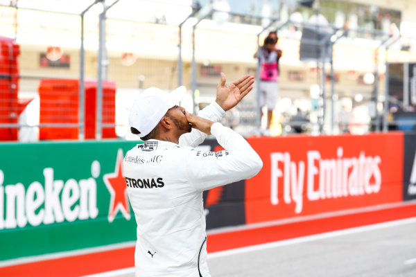 Circuit of the Americas, Austin, Texas, United States of America. Saturday 21 October 2017. Lewis Hamilton, Mercedes AMG, blows kisses to the fans from the grid after securing pole. World Copyright: Steven Tee/LAT Images  ref: Digital Image _O3I4022