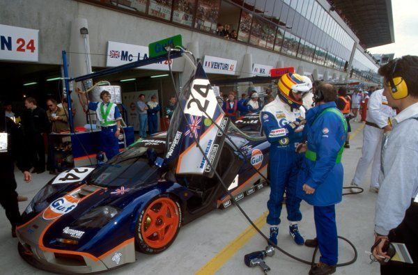 Mark Blundell (GBR) exits the GTC Gulf Racing McLaren F1 GTR during a pit stop. Le Mans 24 Hours, Le Mans, France, 18-19 June 1995.