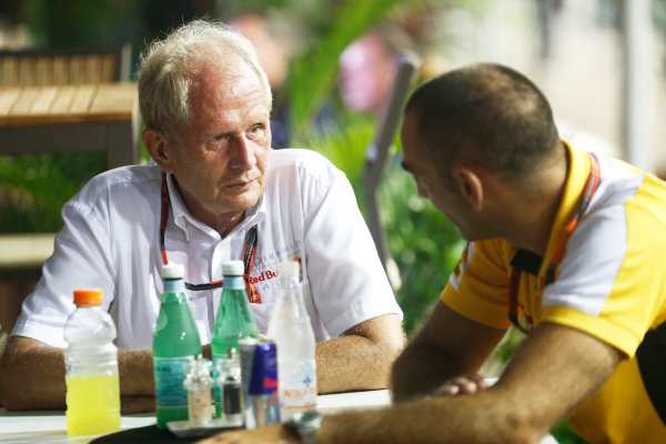 Marina Bay Circuit, Singapore. Saturday 19 September 2015. Helmut Markko, Consultant, Red Bull Racing, with Cyril Abiteboul, Head Engineer, Renault Sport F1. World Copyright: Alastair Staley/LAT Photographic ref: Digital Image _R6T6058