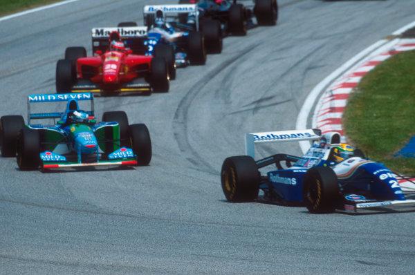 Imola, Italy.29/4-1/5 1994.Ayrton Senna (Williams FW16 Renault) leads Michael Schumacher (Benetton B194 Ford), Gerhard Berger (Ferrari 412T1) and Damon Hill (Williams FW16 Renault) at the start.Ref-94 SM 32.World Copyright - LAT Photographic