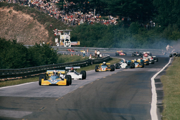 Rouen-les-Essarts, France. 25th June 1972. Rd 7.Mike Hailwood, Surtees TS10 - Ford BDA/Brian Hart, 2nd position, leads the field at the start, action.World Copyright: LAT Photographic.