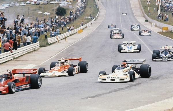 Vittorio Brambilla, Surtees TS19 Ford and Jochen Mass, McLaren M23 Ford battle for position behind John Watson, Brabham BT45 Alfa Romeo.