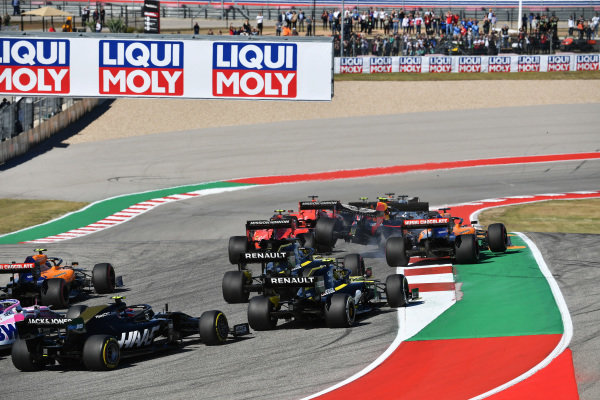 Alexander Albon, Red Bull RB15 is launched into the air at the start, as he battles between Charles Leclerc, Ferrari SF90 and Carlos Sainz Jr., McLaren MCL34 at the start