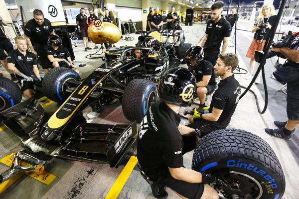Romain Grosjean, Haas F1, uses a wheel gun opposite Kevin Magnussen, Haas F1