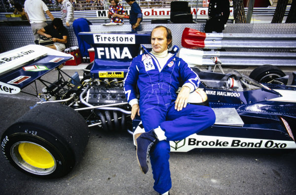 Mike Hailwood relaxing on the side pod of his Surtees TS14A Ford.