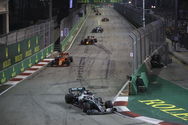 Lewis Hamilton, Mercedes AMG F1 W10, leads Sebastian Vettel, Ferrari SF90, Max Verstappen, Red Bull Racing RB15, and Valtteri Bottas, Mercedes AMG W10