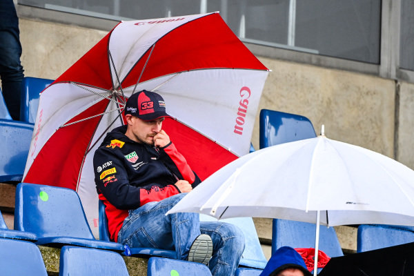 Fans in the grandstands as the rain falls