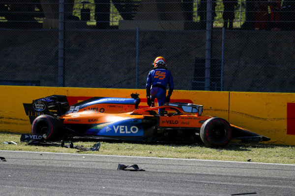 Carlos Sainz, McLaren, climbs out of his damaged car