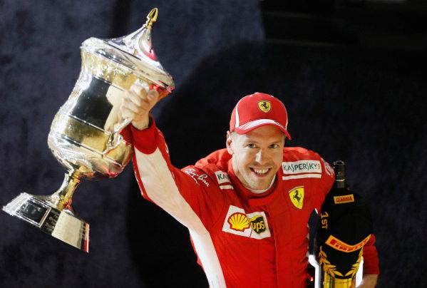 Sebastian Vettel, Ferrari, 1st position, celebrates with his trophy.