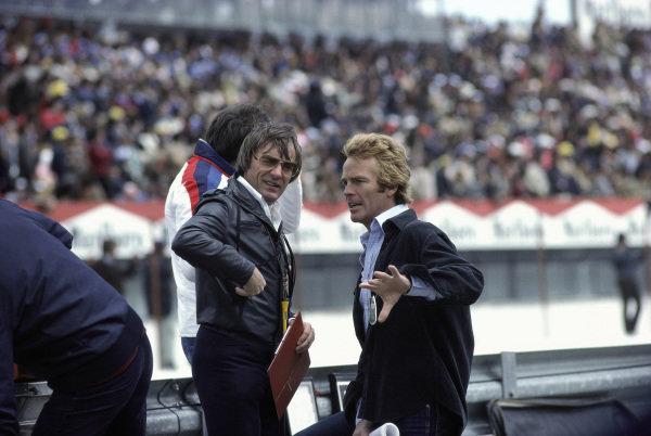 Bernie Ecclestone and Max Mosley talk in the pits.
