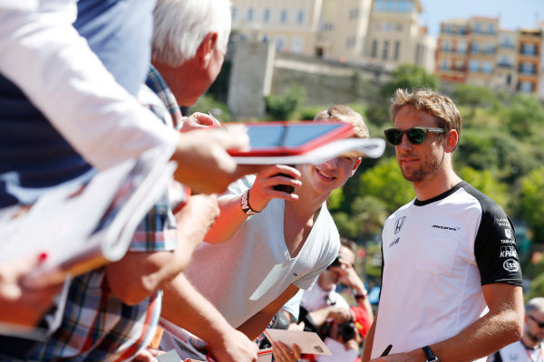 Monte Carlo, Monaco. Friday 22 May 2015. Jenson Button, McLaren meets his fans. World Copyright: Charles Coates/LAT Photographic. ref: Digital Image _N7T4173