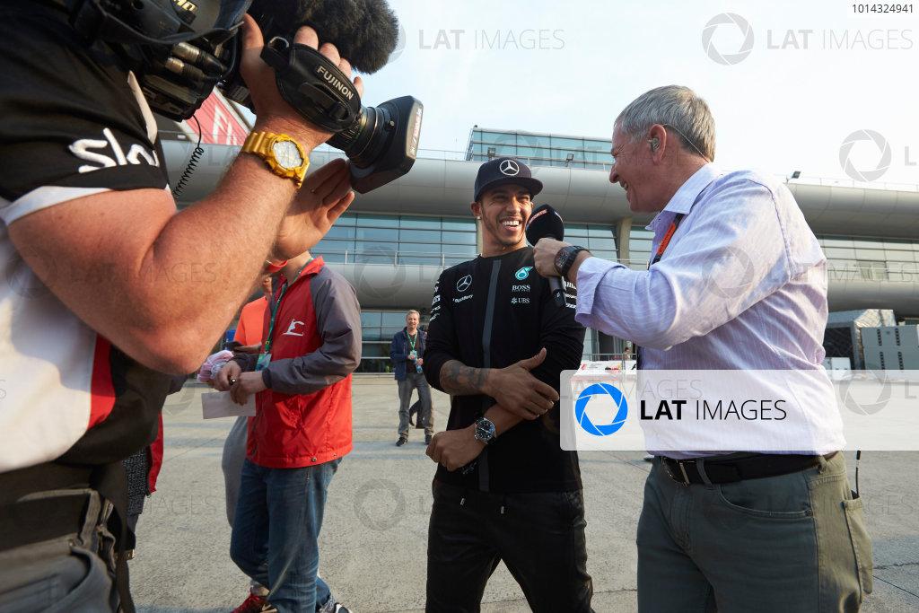 Shanghai International Circuit, Shanghai, China. Sunday 12 April 2015. Lewis Hamilton, Mercedes AMG, is interviewed by Martin Brundle, Commentator, Sky Sports F1. World Copyright: Steve Etherington/LAT Photographic. ref: Digital Image SNE11448