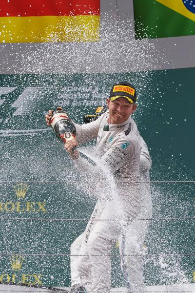 Red Bull Ring, Spielberg, Austria. Sunday 21 June 2015. Nico Rosberg, Mercedes AMG, 1st Position, sprays the victory Champagne. World Copyright: Steve Etherington/LAT Photographic. ref: Digital Image SNE24795