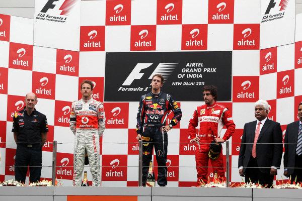 The podium (L to R): Jenson Button (GBR) McLaren, Sebastian Vettel (GER) Red Bull Racing and Fernando Alonso (ESP) Ferrari.  Formula One World Championship, Rd 17, Indian Grand Prix, Buddh International Circuit, Greater Noida, New Delhi, India, Race, Sunday 30 October 2011.