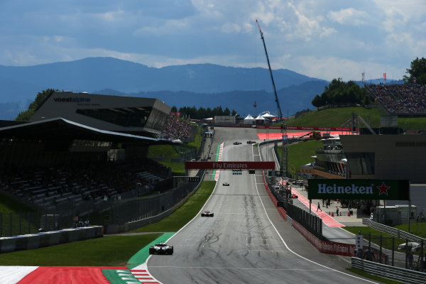 Red Bull Ring, Spielberg, Austria. Friday 7 July 2017. Esteban Ocon, Force India VJM10 Mercedes, leads Lance Stroll, Williams FW40 Mercedes. World Copyright: Charles Coates/LAT Images ref: Digital Image AN7T0603