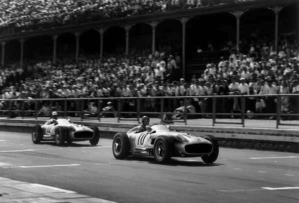 Aintree, Great Britain. 16th July 1955.Juan Manuel Fangio (Mercedes-Benz W196) 2nd position, leads Stirling Moss (Mercedes-Benz W196) 1st position, action.World Copyright: LAT PhotographicRef: Autosport b&w print