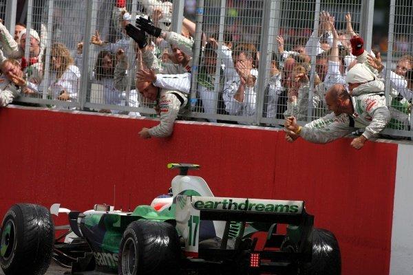 Rubens Barrichello (BRA) Honda RA108 crosses the line to finish 3rd. Formula One World Championship, Rd 9, British Grand Prix, Race, Silverstone, England, Sunday 6 July 2008.