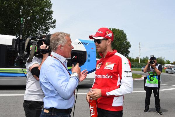 Johnny Herbert (GBR) Sky TV talks with Sebastian Vettel (GER) Ferrari on the drivers parade at Formula One World Championship, Rd7, Canadian Grand Prix, Race, Montreal, Canada, Sunday 7 June 2015.