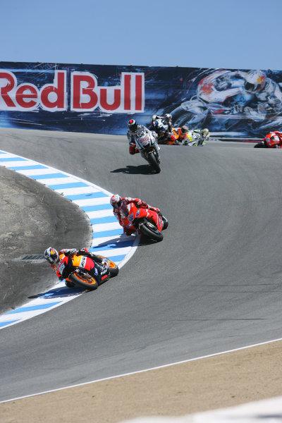 USA Laguna Seca 23-25 July 2010Dani Pedrosa Repsol Honda Team leads Stoner and Lorenzo on lap 2