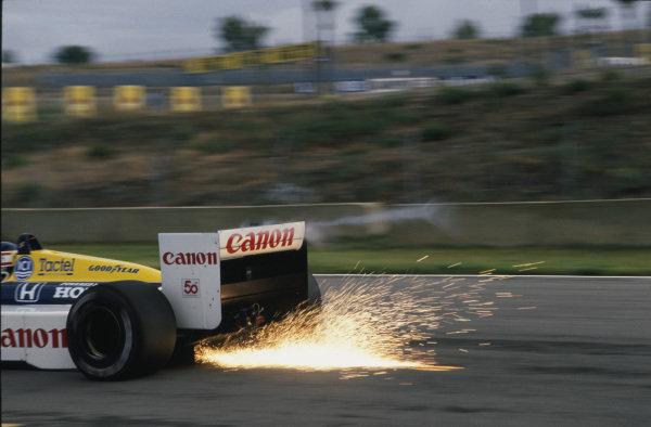 Jerez, Spain.25-27 September 1987.Nigel Mansell (Williams FW11B Honda) 1st position, action.Ref: 35mm Transparency.