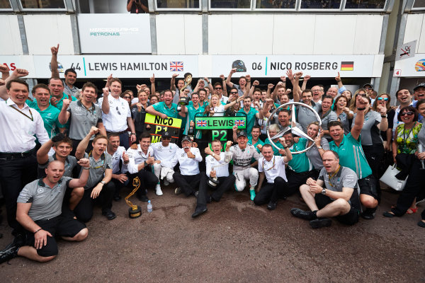 Monte Carlo, Monaco. Sunday 25 May 2014. Nico Rosberg, Mercedes AMG, 1st Position, Lewis Hamilton, Mercedes AMG, 2nd Position, Toto Wolff, Executive Director (Business), Mercedes AMG, Dr Dieter Zetsche, CEO, Mercedes Benz, Paddy Lowe, Executive Director (Technical), Mercedes AMG, and the Mercedes AMG team celebrate. World Copyright: Steve Etherington/LAT Photographic. ref: Digital Image SNE20199 copy