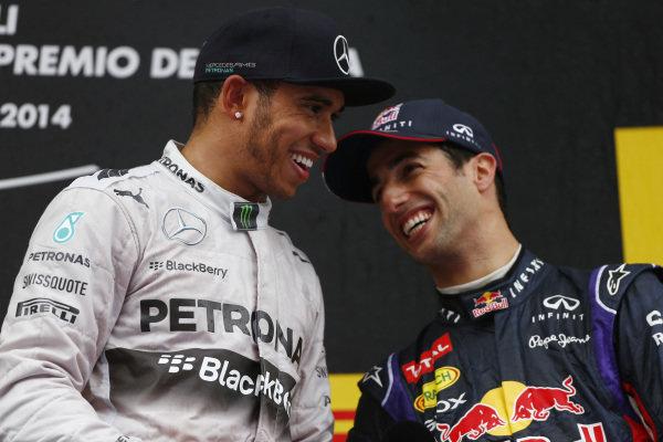 Circuit de Catalunya, Barcelona, Spain. Sunday 11 May 2014. Lewis Hamilton, Mercedes AMG, 1st Position, and Daniel Ricciardo, Red Bull Racing, 3rd Position, on the podium. World Copyright: Andy Hone/LAT Photographic. ref: Digital Image _ONY2390