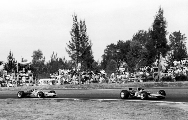 Race winner Graham Hill (GBR) Lotus49B, and World Champion as a result, leads rival Jackie Stewart (GBR) Matra MS10, whose bid for glory ended when a misfire dropped him to seventh place. Mexican Grand Prix, Mexico City, 3 November 1968.