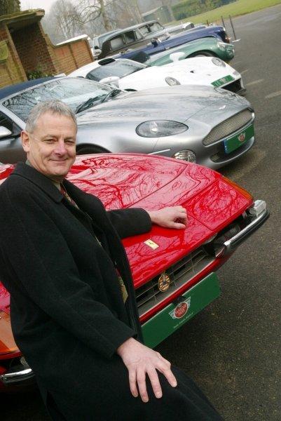 David Grace (GBR) and a Ferrari Daytona, Aston Martin Vanquish and Porsche 911 GT1 road car.Marque Park Launch, Henley, London, England, 6 February 2003.DIGITAL IMAGE