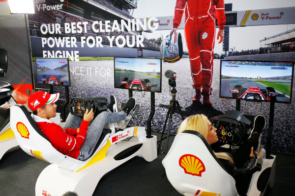 Silverstone, Northamptonshire, UK.  Thursday 13 July 2017. Sebastian Vettel, Ferrari, plays a computer game. World Copyright: Andy Hone/LAT Images  ref: Digital Image _ONZ2790