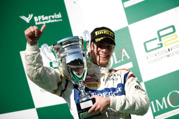 Imola, Italy. 20th March 2011. Sunday Race.Giedo Van der Garde, (NED, Barwa Addax Team) on the podium. Portrait.   World Copyright: Drew Gibson/GP2 Media Service.ref: Digital Image _Y8P0576