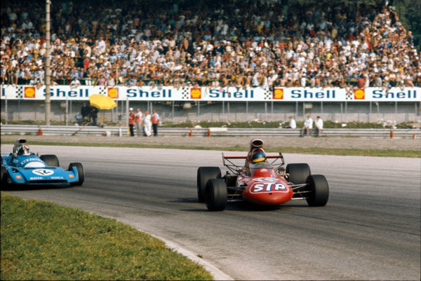 Monza, Italy. 3 - 5 September 1971.Ronnie Peterson (March 711-Ford), 2nd position, gets sideways in Parabolica ahead of Chris Amon (Matra-Simca MS120B), 6th position.  Ref: 71ITA50. World Copyright: LAT Photographic.